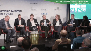 Panelists discussing on stage at the Clean Growth Event Webcast