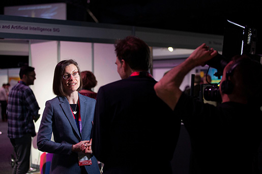 An exhibitor being interviewed on camera at the Robotics and AI Industry showcase in Manchester