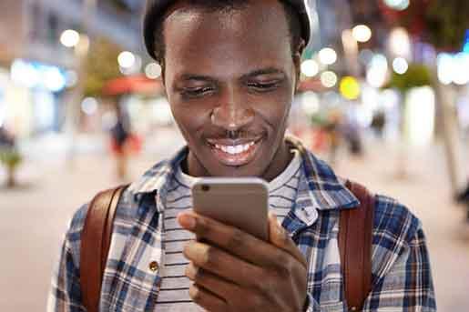 Man smiling at mobile phone